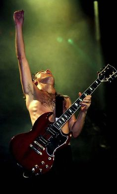 Angus Young... He's one of the most awesome people I have ever seen! ;)