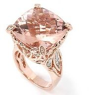 Citrine cushion cut center set in rose gold mount with diamond accents. S.T. Kluh Jewelers