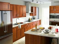 So conflicted with the type of cabinetry I really want for our kitchen! Cherry, red oak, white oak, hard maple, hickory, birch, ash or pine wood? But, laminate can be SO nice and elegant too! Oh! What's a girl to do...?!