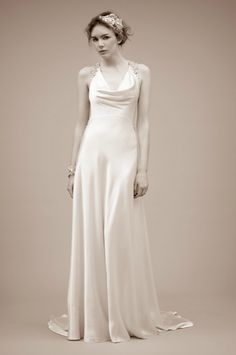 Jenny Packham- Lady Astor (2011 collection). Very chic & love the strap shoulder detailing.