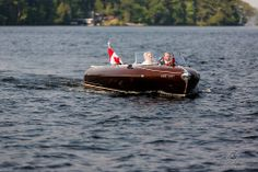The bride and her father arrive to Muskoka Lakes wedding in classic boat! Muskoka Lakes Golf and country club weddings