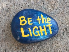 Be the light. Hand painted rock by Caroline.