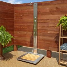 The sleek design of the Abner Outdoor Stainless Steel Shower Panel brings contemporary style to your patio or poolside area. This product features a rainfall shower head, hand shower, and bamboo tray. Outdoor Pool Shower, Outdoor Shower Enclosure, Outdoor Shower Fixtures, Outdoor Sauna, Outside Showers, Garden Shower, Outdoor Bathrooms, Outdoor Baths, Modern Bathrooms