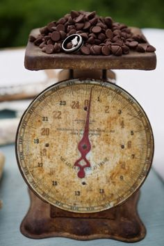 A vintage scale makes a casually elegant display for a pile of delicious #chocolates at a party!