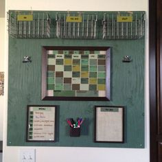 Organization center: mail (in, to do, out), paint chip calendar, to do list, weekly menu, a clip for grocery list, and one for receipts.  Love how it turned out.  Used burlap, paint chips, letter stickers, frames from Walmart (spray painted), baskets from crate & barrel, and plywood