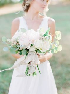 Peony, rose, astilbe, and eucalyptus wedding bouquet: Wedding Dress: The Dress Theory - http://www.stylemepretty.com/portfolio/camille-wynn Floral Design: Mint Springs Farm - http://www.stylemepretty.com/portfolio/mint-springs-farm Photography: Julie Paisley Photography - juliepaisley.com   Read More on SMP: http://www.stylemepretty.com/2017/02/21/rustic-romantic-tennessee-fall-wedding/
