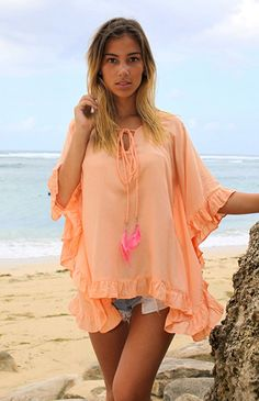 Lovely poncho with feathers and ruches! In peach, nude or azure. Available at: