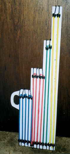 idea for bungee cords - now just add wrapping paper! Garage Organization, Organization Ideas, Storage Ideas, Cord Storage, Bungee Cord, Organizing Your Home, Home Hacks, Cords, Wind Chimes