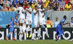 Costa Rica\'s national soccer players form a wall as Italy's Andrea Pirlo attempts a free kick, next to Italy's Claudio Marchisio and Mario ...