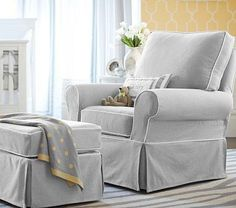 PB Kids Comfort Swivel Glider & Ottoman in dove grey with ivory piping. Beautiful comfy and cozy and the first thing you see when you come up the stairs.