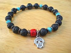 Men's/Unisex Spiritual Protection Bracelet with Semi Precious Red Coral, Turquoise, Lava, Day of the Death Skull Charm, Gunmetal, Wood
