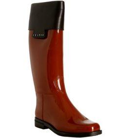Celine red rubber leather trim rain boots, $384.99 @bluefly_com Fabulous rain gear!