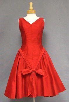 1950's taffeta cocktail dress. Love it!  http://www.vintageous.com/dressy1.htm