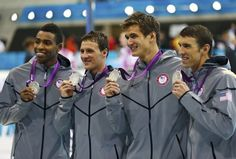 Cullen Jones, Ryan Lochte, Nathan Adrian and Michael Phelps (L-R) of the U.S. pose with their silver medals in the men's 4x100m freestyle relay victory ceremony during the London 2012 Olympic Games at the Aquatics Centre July 29, 2012.