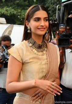 Sonam Kapoor looks gorgeous in a pale pink and beige Anavila Misra sari paired with Amrapali jewellery and a poker straight hairstyle given to her by Namrata Soni. via Voompla.com