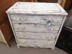 SOLD - This shabby chic 4 drawer dresser/chest has been painted with cream stencil work - distressed, antiqued, and finished with a dark wax. ***** In Booth F9 at Main Street Antique Mall 7260 E Main St (east of Power RD on MAIN STREET) Mesa Az 85207 **** Open 7 days a week 10:00AM-5:30PM **** Call for more information 480 924 1122 **** We Accept cash, debit, VISA, MasterCard or Discover.