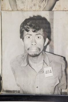 An unidentified prisoner suspected of crimes against Pol Pot's regime photographed while being checked in at the S-21 death camp in Cambodia, c. 1975-78.