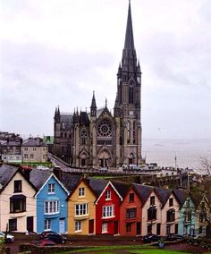 Exploring the small heritage town of Cobh in Cork. In the background of this photo is the grand old Saint Colmans Cathedral. Sitting in front of it are the beautiful old and colourful rowed houses of West View colloquially known by locals as the 'Deck of Cards'. #deckofcards #westview #cathedral #cobh #cork #ireland #colorful #colourful #architecture #beautiful #travel #spottly #discoverearth #intrepidista by intrepidista