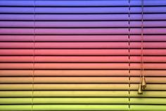 Spray paint vinyl blinds any color to match your decor.  As simple as cleaning them, spraying with a primer and then with your favorite color/s or an ombre look.  Clever idea!