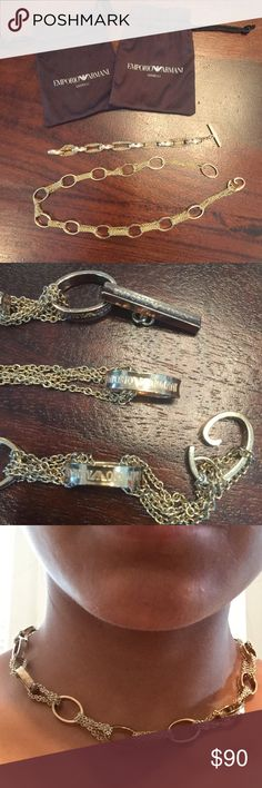 EMPORIO ARMANI choker and bracelet set AUTHENTIC gold tone link/chain bracelet and choker set. by EA. bar on bracelet and hook and eye on choker are adjustable. rhodium plated. logo engraved on each link. 2 pouches included to separate and properly store!! bar is slightly tarnish by 4mm on non engraved side (unseen when worn) stand out of the crowd with a DIFFERENT style choker ;) Emporio Armani Jewelry Necklaces