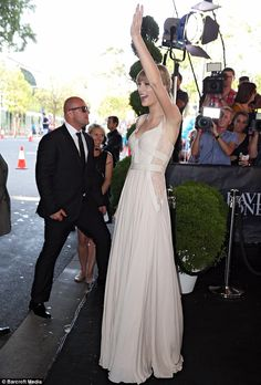 She's loving it! Taylor seemed to be in her element as she waved to the numerous fans who had turned out to welcome her Down Under