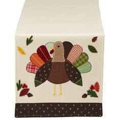 Add a little whimsical flair to your Thanksgiving table this year with this appliqued turkey table runner.