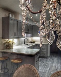 Kitchen renos: shaker style cabinets, stained gray maple wood, slow closing doors and drawers. Crystal chandelier from Home Depot.