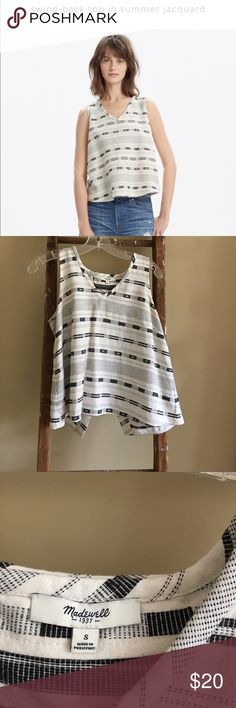Madewell open back tank PRODUCT DETAILS A simple swingy top with a flattering V-neck. Crafted of striped Turkish cotton, the cutaway back overlaps with a charming button detail (and reveals just a hint of skin).    True to size. Cotton/viscose. Machine wash. Import. Madewell Tops Tank Tops