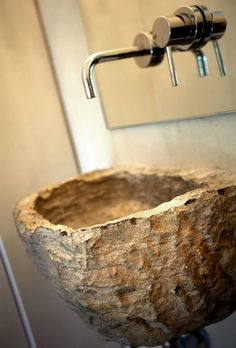 rustic modern mix. carved stone basin sink/contemporary fixtures.