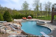 Michigan Custom Hybrid Swimming Pool with a raised spa, waterfall, sun ledge, and diving board.