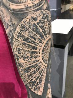 hand fan tattoo. lace hand fan tattoo
