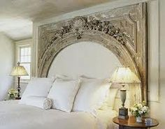 Beautiful headboard. Finding a piece of architecture like that without loosing an arm or leg would be the hard part.