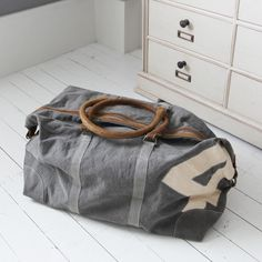 Graham & Green large khaki weekend bag. This canvas and leather weekend bag is the perfect solution to travelling in style without losing practicality. Love it, but too expensive I think! £175.00