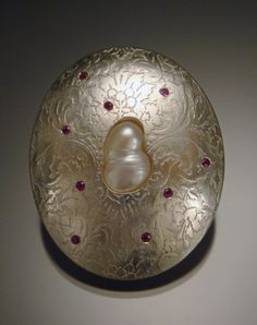 Womb Brooch #2 by Jill Baker Gower - Argentium sterling silver, thread, freshwater pearls, rubies, stainless steel 2011