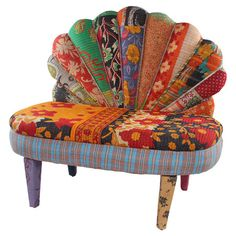 Mango wood-framed settee with a peacock-inspired design and exotic textile upholstery.   Product: SetteeConstruction ...