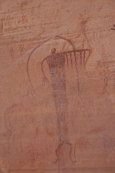 6 assistants (the number hanging from her arm) worked with this person to help create and expand subtle energy