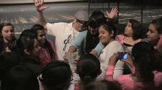 Bilingual rapper Guero Loco poses for photos with students at Deming High School in New Mexico on April 27th, 2015.