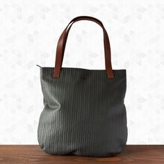 Ryz Tote. Handmade from embossed buffalo leather in classic Elk colours. This bag has a thicker saddlery leather strap and top zip closure. It has an internal phone pouch and a small zippered pouch. $213