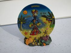 A personal favorite from my Etsy shop https://www.etsy.com/listing/207422974/gorgeous-bahamas-souvenir-resin-plate