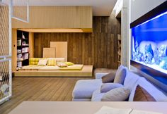 Fantastic Big Aquarium with Clean Wooden Wall and Floor