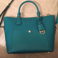 Michael kors Greenwich large leather grab bag Beautiful Michael Kors Greenwich large leather grab bag in tileblue. Comes with dust bag. Sorry I do not trade. 15.5x10x7.5 Michael Kors Bags Shoulder Bags