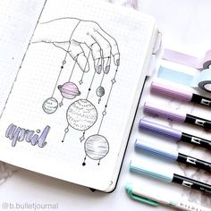 Bullet journal monthly cover page, April cover page, hand lettering, universe hanging from hand drawing. | @b.bulletjournal