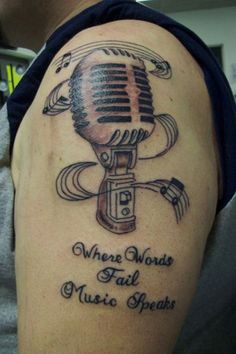 microphone tattoo, where words fail music speaks ~