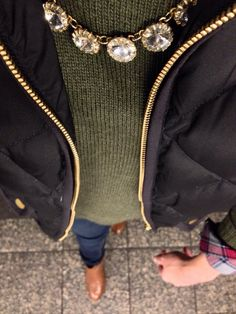 Olive green sweater, black vest, and booties outfit