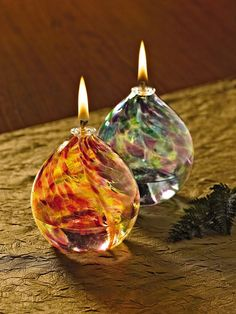 Buy a Lotus Bud Oil Lamp from Gardener's Supply. These mouth-blown glass oil lamps shimmer with dappled color. A fiberglass wick safely draws up the oil for a smokeless, odorless flame. Lotus Bud, Colorful Garden, Glass Garden, Oil Lamps, Garden Supplies, Lamp Light, Birthday Candles, Lanterns, Glass Art