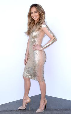 Jennifer Lopez shows off her amazing bod in a gold sequinned Georges Chakra dress!