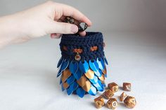 Dice bag! Best ones ever!  https://www.etsy.com/listing/604300286/dd-dice-bag-blue-and-bronze-pouch