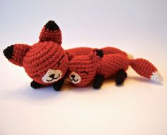 Tiny woodland foxes cuddle together in this pair of amigurumi. The special relationship of a mother and her baby is celebrated in a sweet set of crocheted foxes. Simple stitches and soft wool-blend ya