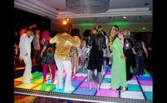 LED Multi Coloured Dance Floor is a must have for any 70's party!  http://bigfootevents.co.uk/entertainment/Themed-Events/1970%E2%80%99s-Seventies-Glam-Rock-Disco.aspx