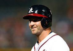 Dan Uggla #26 of the Atlanta Braves smiles after hitting a infield single in the eight inning to the Cleveland Indians at Turner Field.